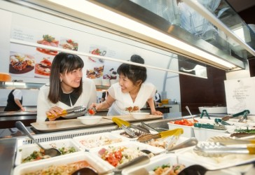Photo of students selecting from the salad bar